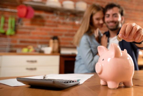 Happy Couple Saving Money